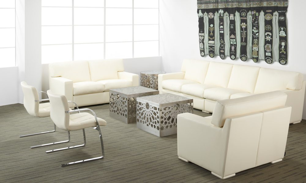 The leather upholstered Baden and Zurich couch and chairs by Nienkamper in white.